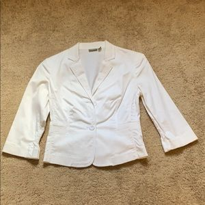 White blazer with detail on back and sleeves
